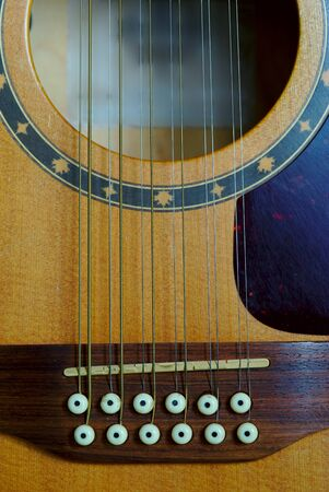 12-string electro-acoustic guitar, bridge detail, violin 写真素材