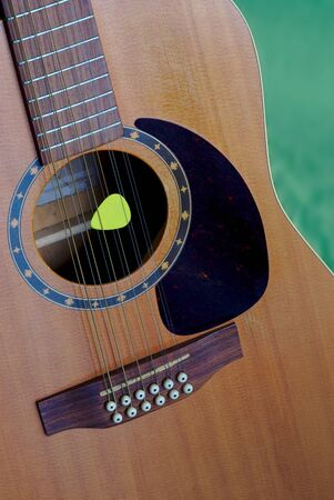 12-string electro-acoustic guitar, and pick, detail, violin making