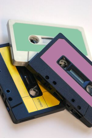 three vintage audio tapes on white background with color labels