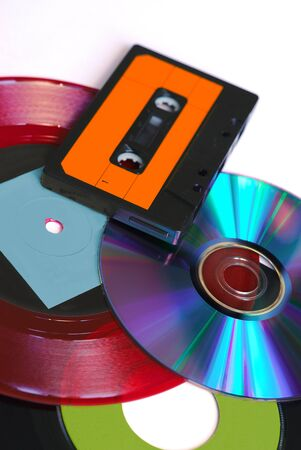 CD, red and black vinyl disc and audio tape on white background 写真素材
