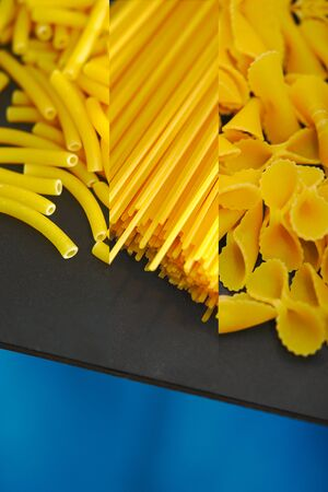 texture, background, spaghetti, farfalle and macaroni on a black table and blue background 写真素材