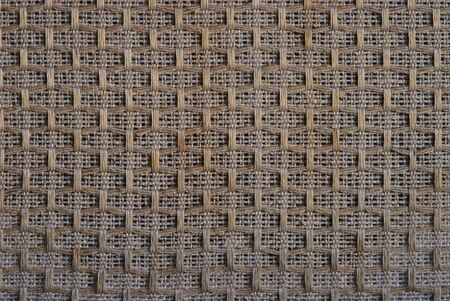 macro close-up of a woven cloth from a vintage radio