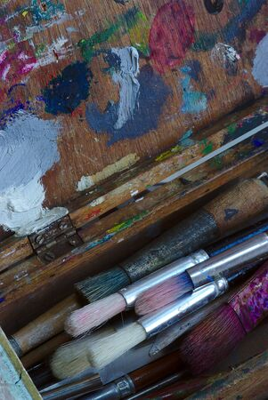 Used paint and brush box in close up 写真素材