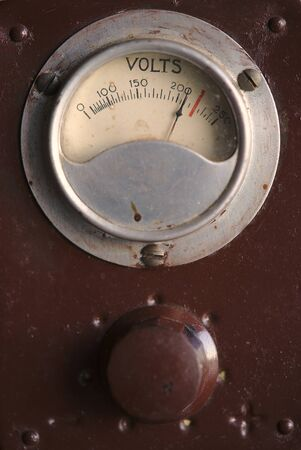 vintage power supply, with voltage indicator dial in action, close-up