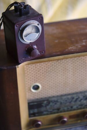vintage wooden radio set and its electric ransformer Фото со стока
