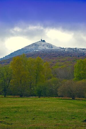 view of Puy de Dome, Auvergne volcano, snow-covered at the top 版權商用圖片