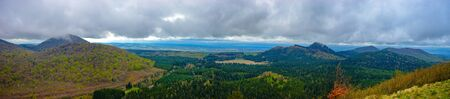 panoramic view of the chain of puys, regional park volcanoes of Auvergne. View of Puy des Goulles Фото со стока