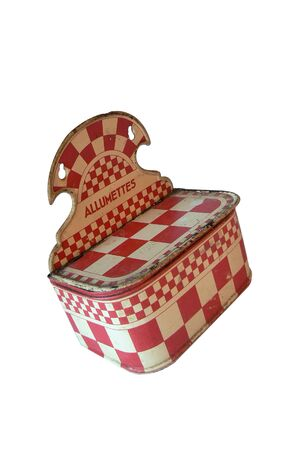 Antiquity. Red and white checkered wall hanger, match box range. Cut off on a white background Banco de Imagens
