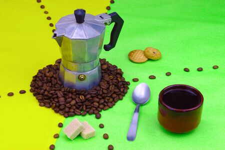 objects evoking coffee with small traditional coffee maker on green and yellow background. Coffee beans.