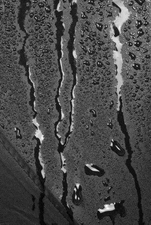 Umbrella cloth and wet black, close up Banco de Imagens