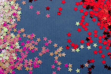 background consisting of small bright stars on blue paper background. For Christmas and New Year