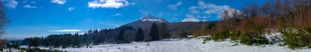 Panoramic shooting the Puy-de-Dome volcano and the campaign snowy in Auvergne. A string of volcanoes of Auvergne. On the way to the Puy de Parioux, col des goules, Puy-de-Dome, Auvergne 写真素材