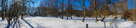 Panoramic shot of the campaign snowy in Auvergne. On the way to the Puy de Parioux, col ghouls, Puy-de-Dome, Auvergne 写真素材