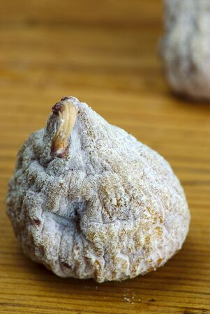 dried fig close-up on a wooden board 写真素材