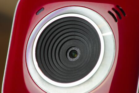 red and white webcam, close-up on the lens