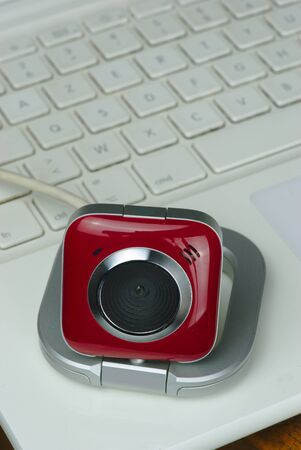 red and white webcam on a white computer keyboard