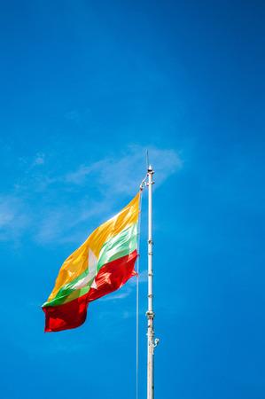 Flag of Myanmar Burma Raised Up in The Sky