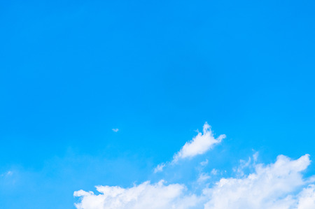 nebulosity: Blue sky with white clouds at the bottom of picture. Stock Photo
