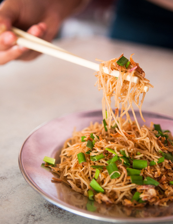 Mie Hoon, fried noodle with pork rib soup.