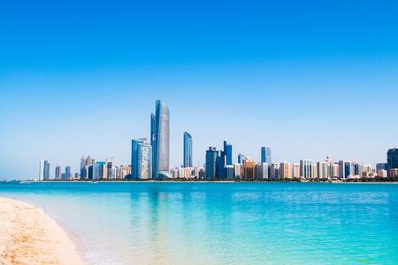 Abu Dhabi sky line and city scene shots from white sand beach on marina island