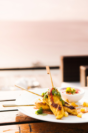 Chicken Satay or malaysian skewer chicken with peanut sauce. Stock Photo