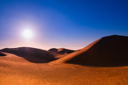 Al Wathna desert and sand dune of Abu Dhabi before sunset