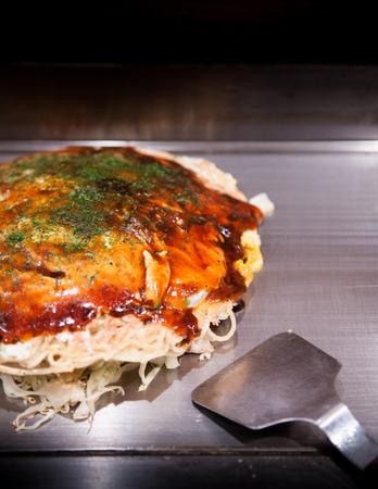 Hiroshima style Okonomiyaki. Hiroshima famous local dishe. Stock Photo