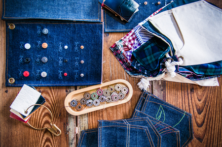 cutting: Jean fabric, jeans rivets, buttons, leather and thread. Stock Photo