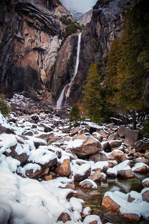 bridalveil fall: Yosemite Waterfalls in winter, rocks covered with snow. Yosemite national park, CA, USA.
