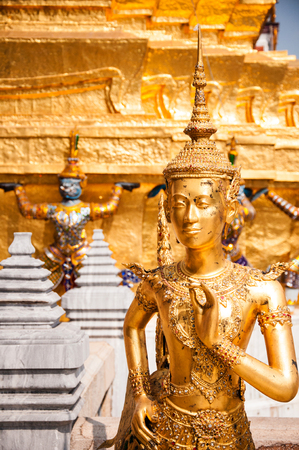 Golden angel statue, Interior of the Grand Palace in Bangkok. Stock Photo
