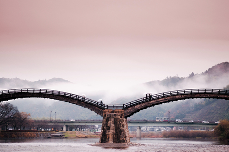 Kintaikyo historic bridge on rainy day in Iwakuni town, Yamaguchi, Japan