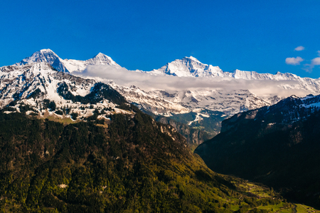 Eiger, Monch and Jungfraujoch peak cover with snow, view from Harder Kulm.