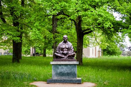 disobedience: May 9, 2016 Geneva, Switzerland : Statue of Mahatma Gandhi in the Ariana park, Geneva, Switzerland. It was unveiled on november 14th 2007, to commemorate the 60th anniversary of Indo - Swiss friendship.