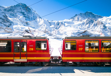 Red train of Jungfrau Bahn at Kleine Scheidegg station. The main transportation to Jungfraujoch