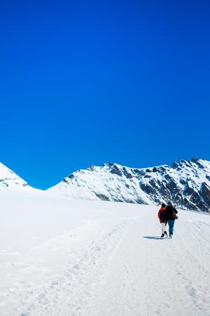 Tourists trekking at Jungfraujoch, Swiss Alps of Switzerland.