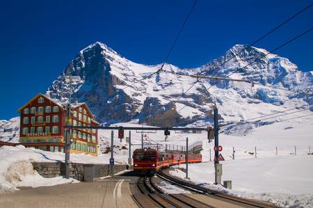 Red train of Jungfrau Bahn at Kleine Scheidegg station. The main transportation to Jungfraujoch