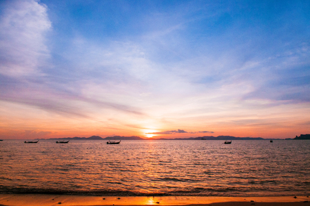 Scene of Tropical Sunset sea and fishing boat, Krabi, Thailand Banco de Imagens