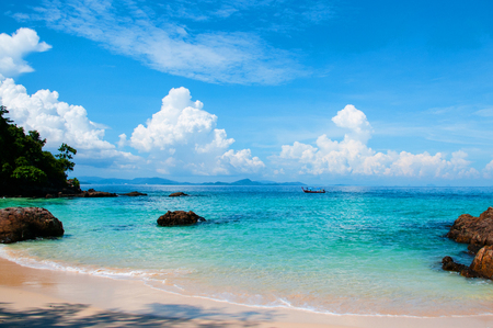 Rock Beach with crystal clear water and boat in summer, Phuket, Thailand 写真素材