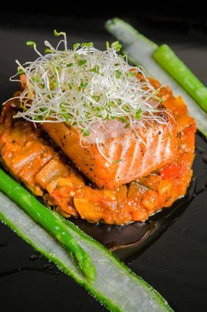 Salmon steak with ratatouille and asparagus