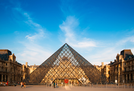 JUNE 8, 2011 PARIS, France : Louvre Pyramid in the evening, the most famous museum and icon of Paris.
