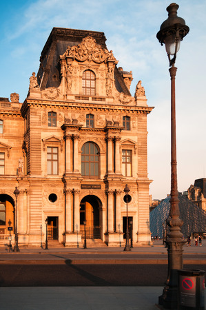 JUNE 8, 2011 PARIS, France : Historic French building at Louvre museum at sunset.
