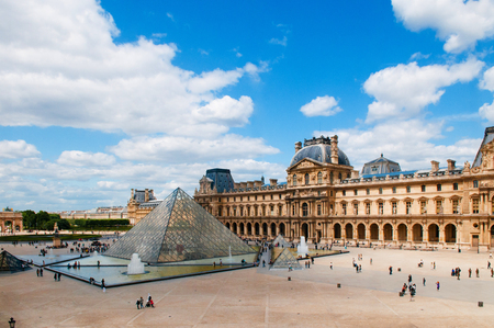 JUNE 8, 2011 PARIS, France : Louvre Pyramid and French building of Louvre museum, the most famous museum of Paris.