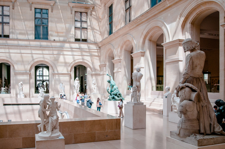 JUNE 8, 2011 PARIS, France : Tourist inside greek room of Louvre museum with marble sculptures. 報道画像