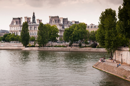 June 9, 2011 PARIS, FRANCE : Tourists enjoy evening at Seine river near Notre Dame Cathedral