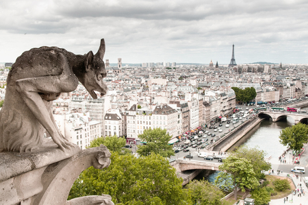 Chimera gargoyle of Notre Dame Cathedral Paris, France.