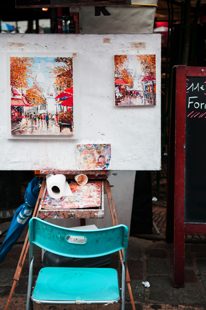 JUNE 6, 2011 Paris, France : Artists chair and tools with finished painting work in Montmartre