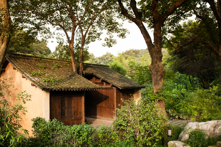 AUG 18, Hangzhou, China : Chinese old country house in the wood near Lingyin Temple, Hangzhou