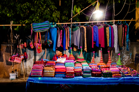 JAN 11, 2010, Maehongson, Thailand : Street shop in Pai district night market, mostly sell Hmong style clothes inspired from traditional Hmong tribal costume.