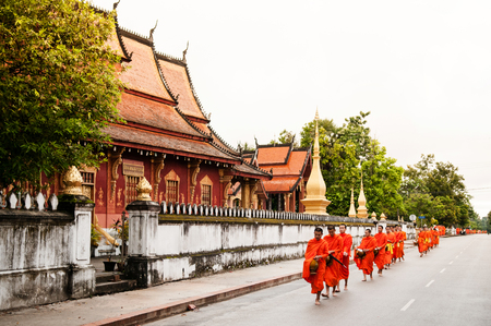 Sep 6, 2011 Luang Prabang, Laos : Traditional Alms giving ceremony of distributing food to buddhist monks on the streets