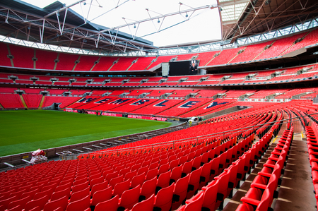 FEB 24, 2011 LONDON, UK : Red seat and interior of Wembley football stadium, London UK.